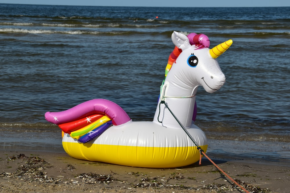 yellow and white inflatable floating unicorn