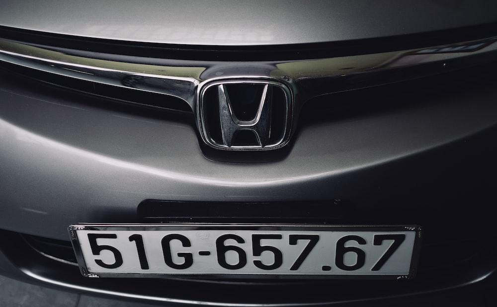 shallow focus photo of Honda emblem