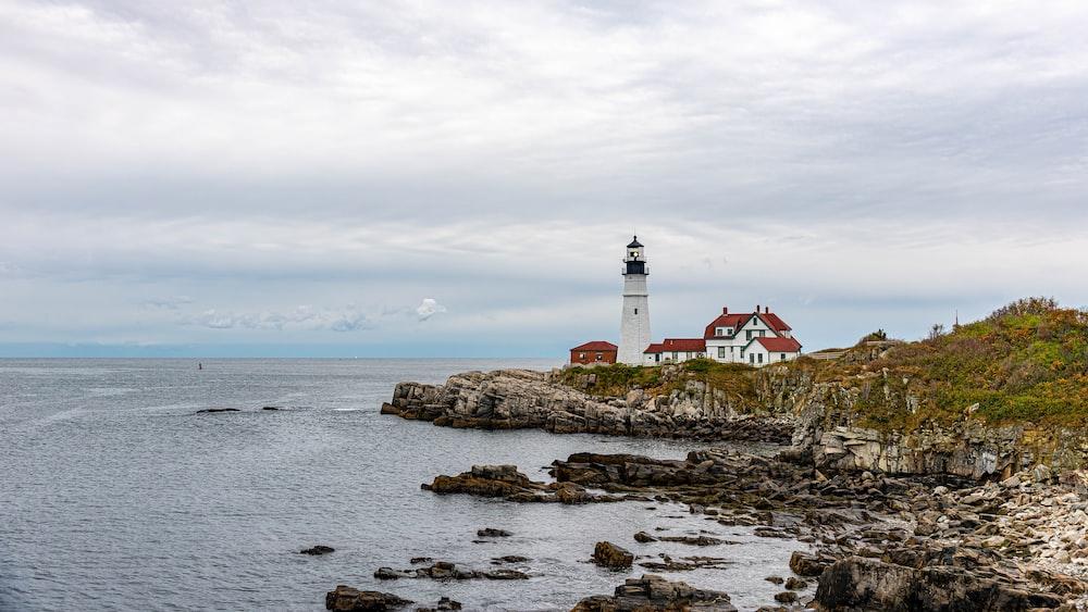 lighthouse near seashore