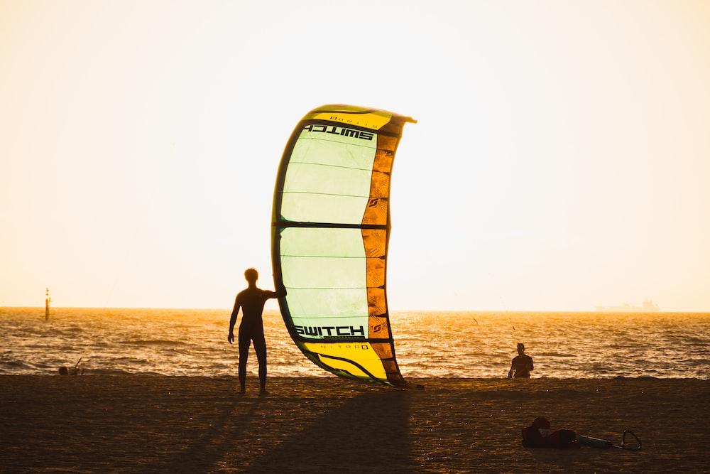 man holding sailboard