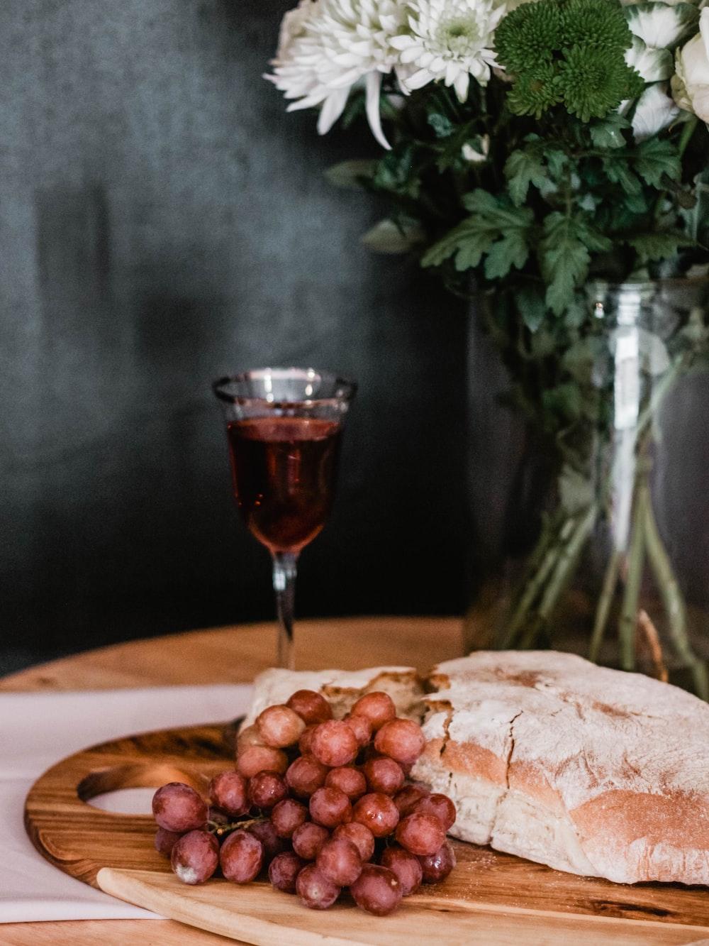 purple grapes beside bread
