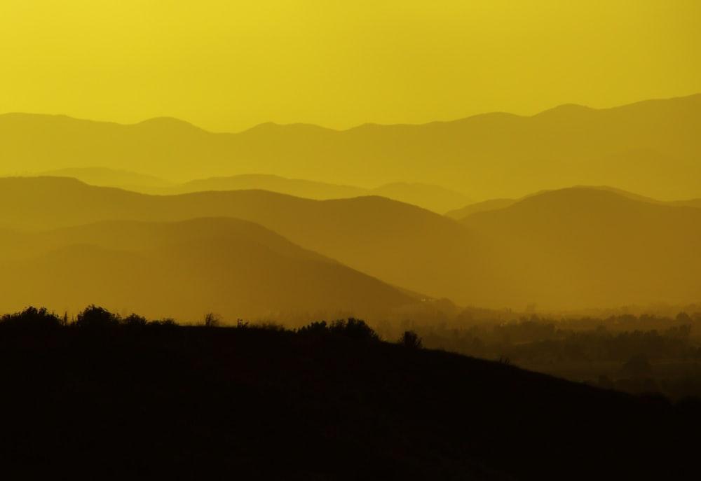 silhouette photo of black mountain ranges
