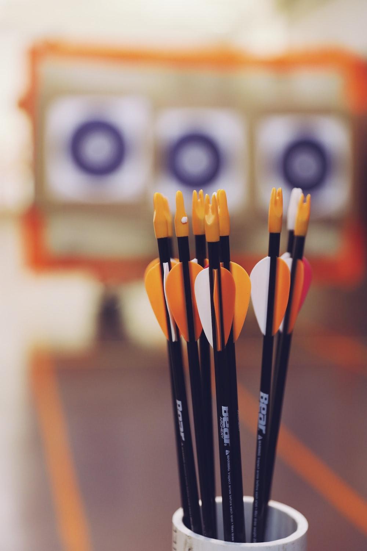 black and orange dart pins