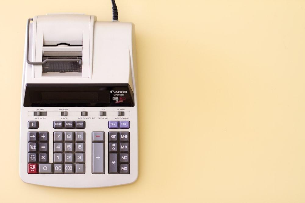 white Canon cash register
