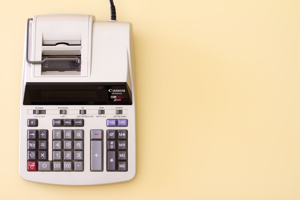 white Canon cash register