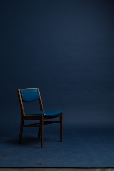 blue and brown padded chair