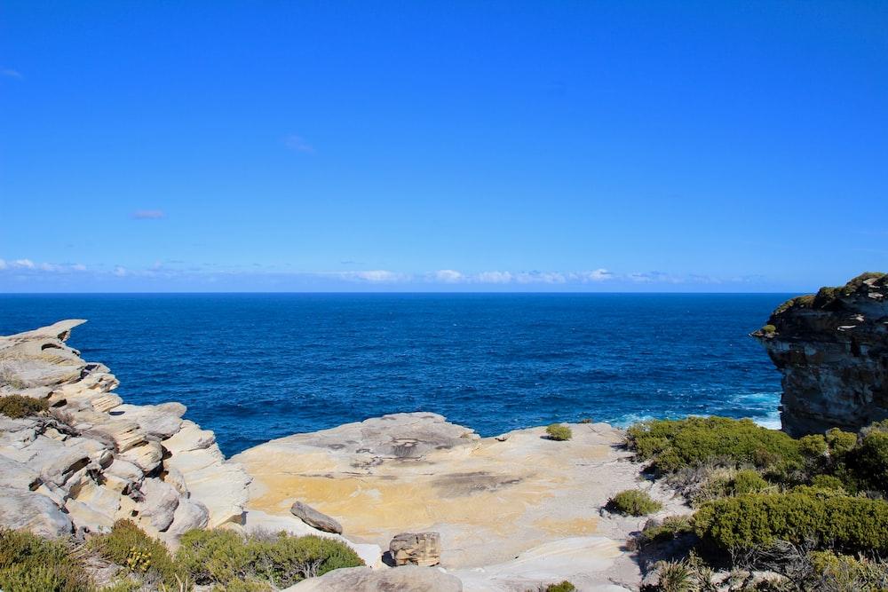 rocks near sea during daytime