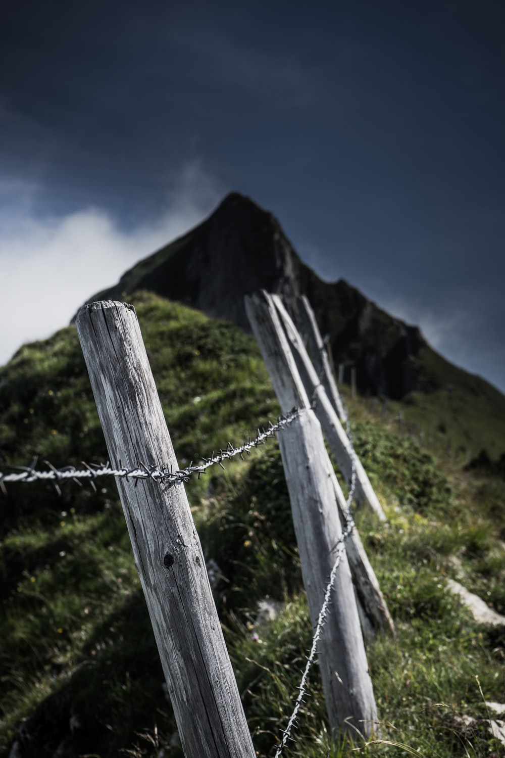 wooden post and barbwire into hill