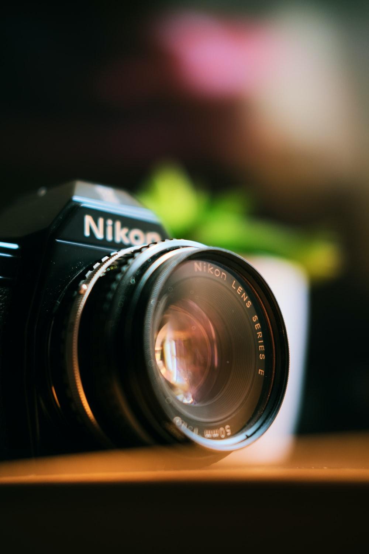 Nikon camera on wooded board