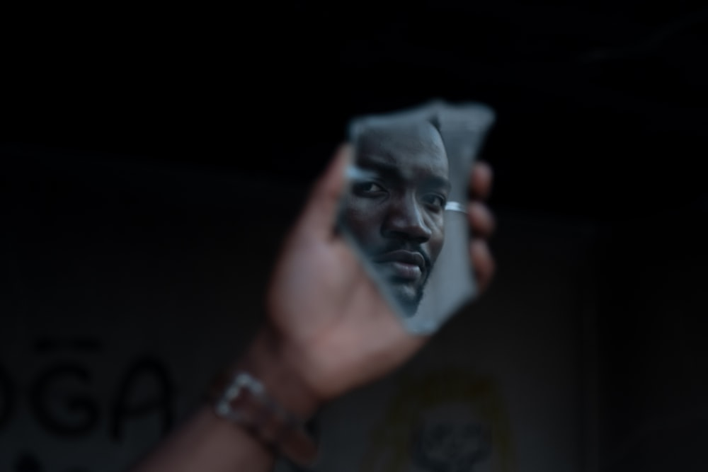man's face reflected on mirror