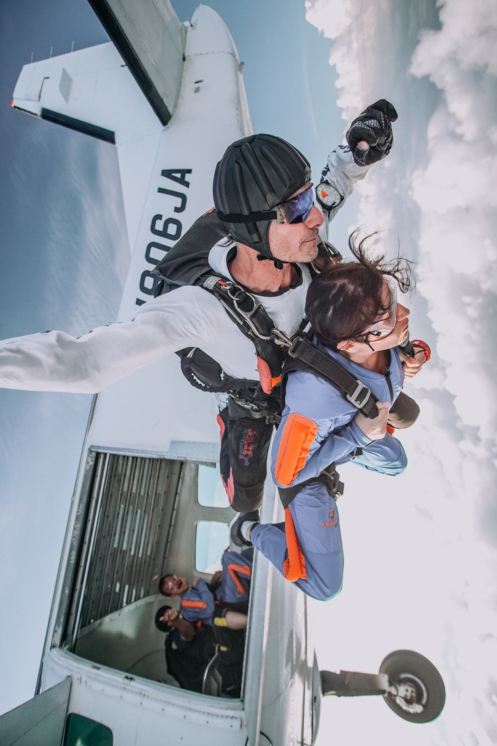 photography of man and woman doing sky diving during daytime