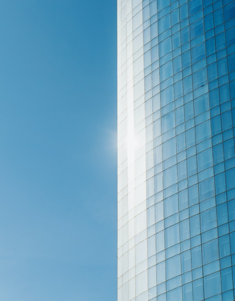 blue glass building photography
