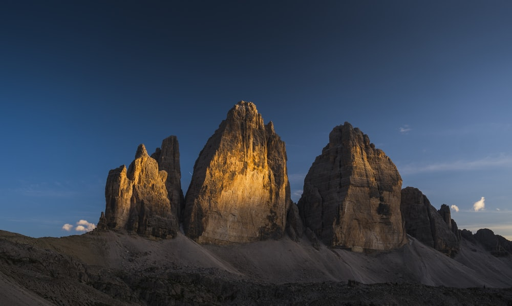 black and brown rock formations during golden hour