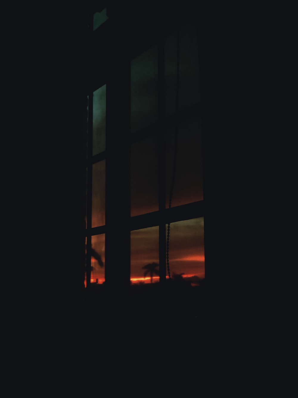 brown wooden glass window