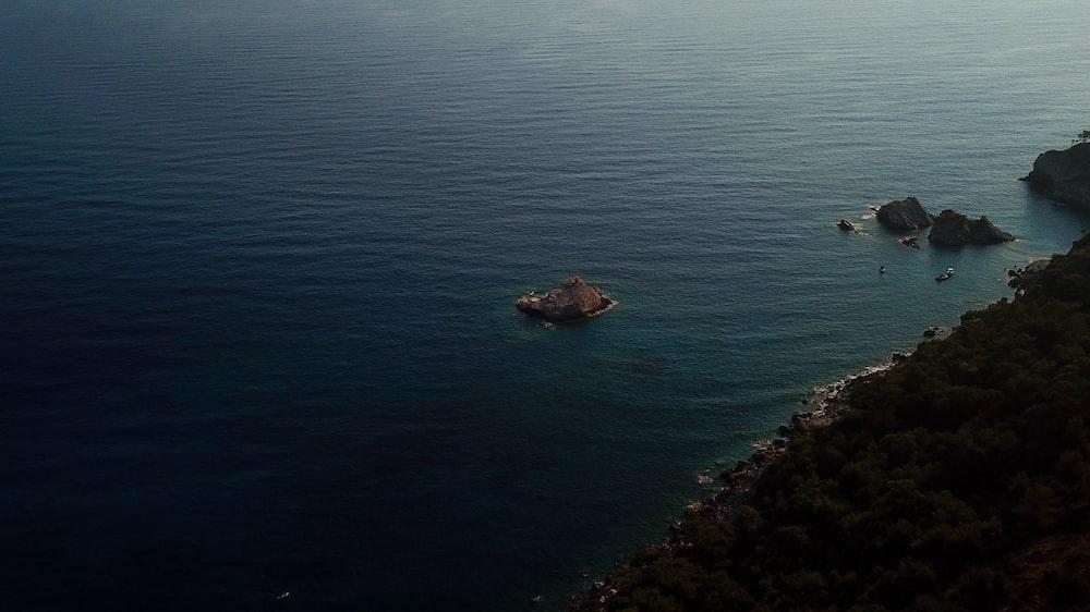 small island on blue sea