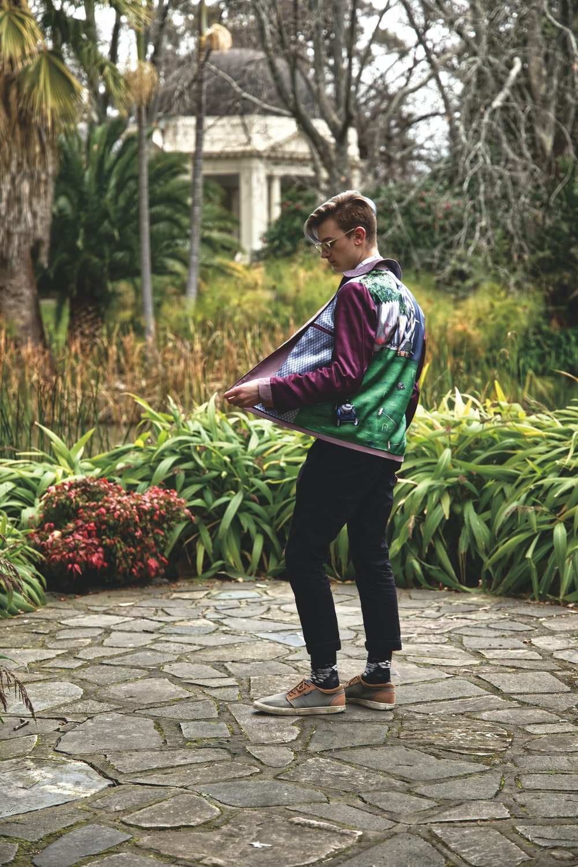 man standing near plants