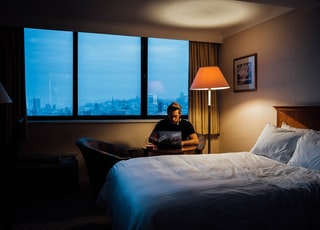 man sits near bed