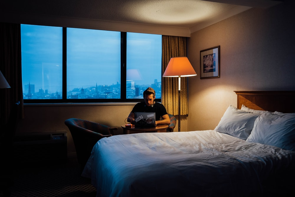 man sits near bed