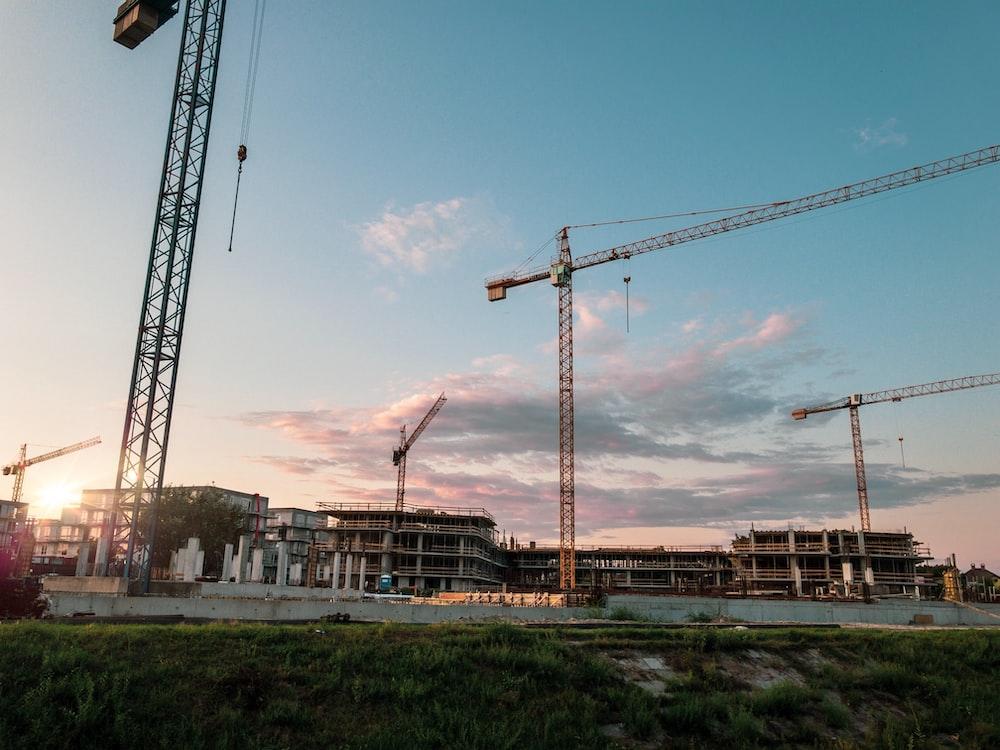 grey metal crane near construction site