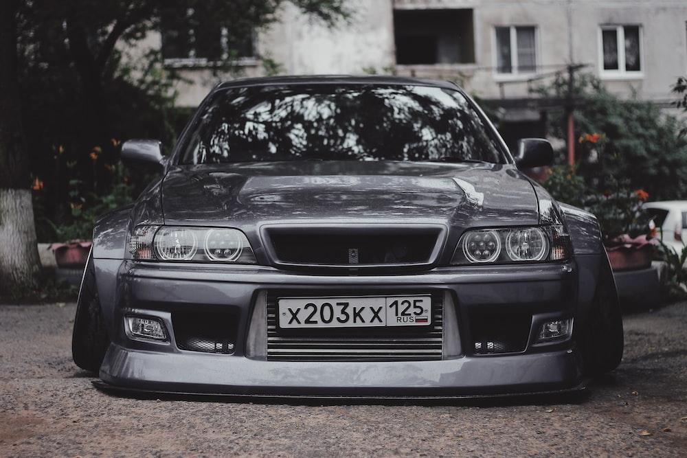 grayscale photo of black vehicle
