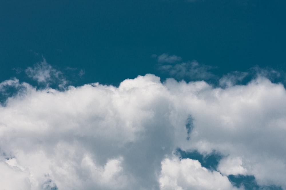 cumulus clouds on blue sky