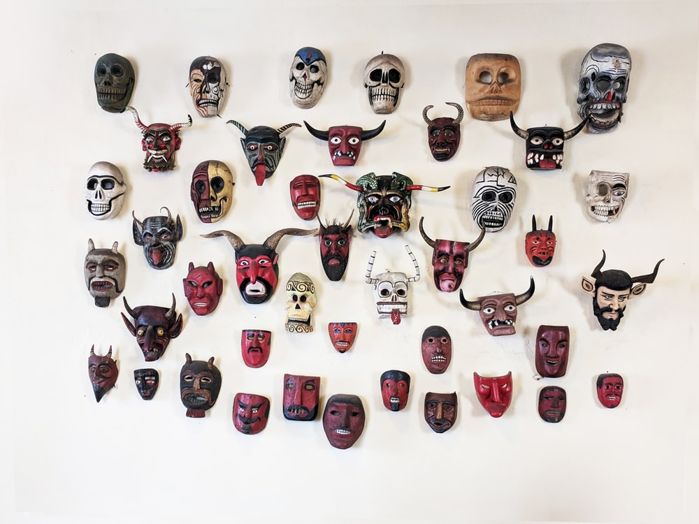assorted mask wall decors