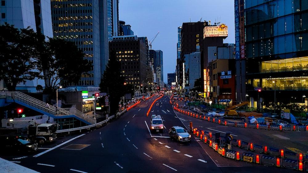 vehicles running on road at night