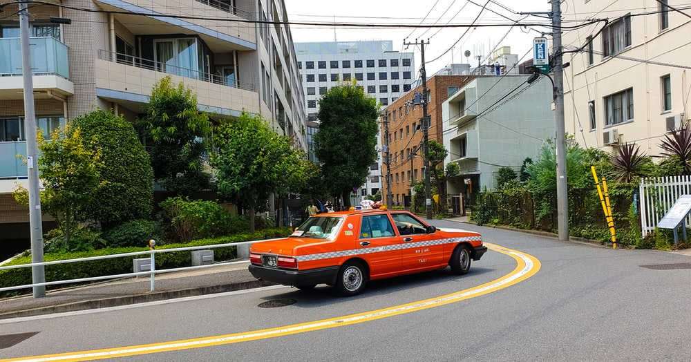 red taxi on road