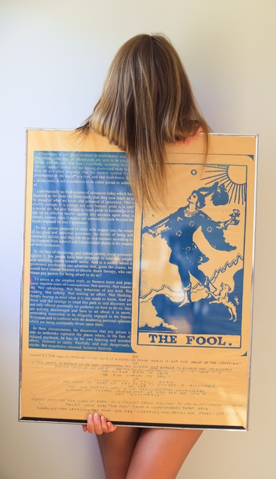 woman holding The Fool poster