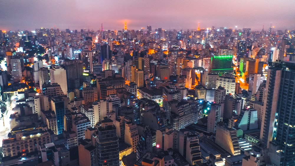 aerial photo of city buildings at night
