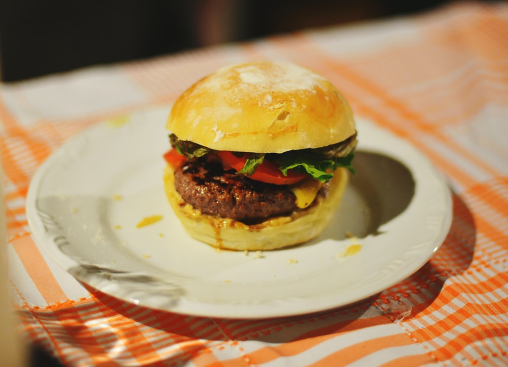 food photography of meat burger with tomatoes and lettuce