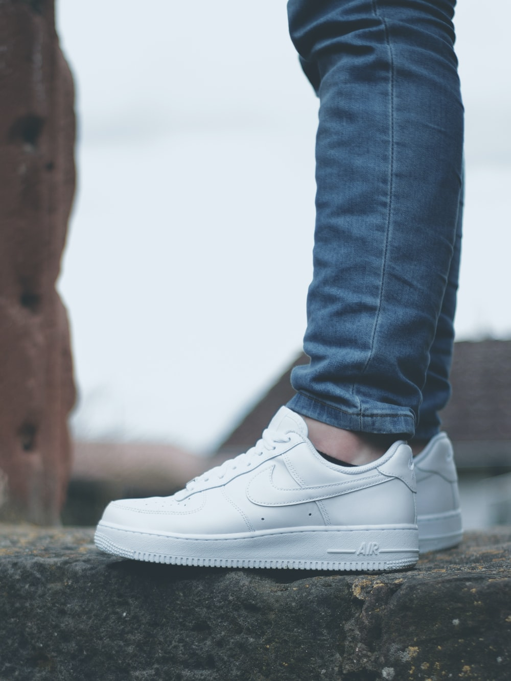 pair of white Nike shoes
