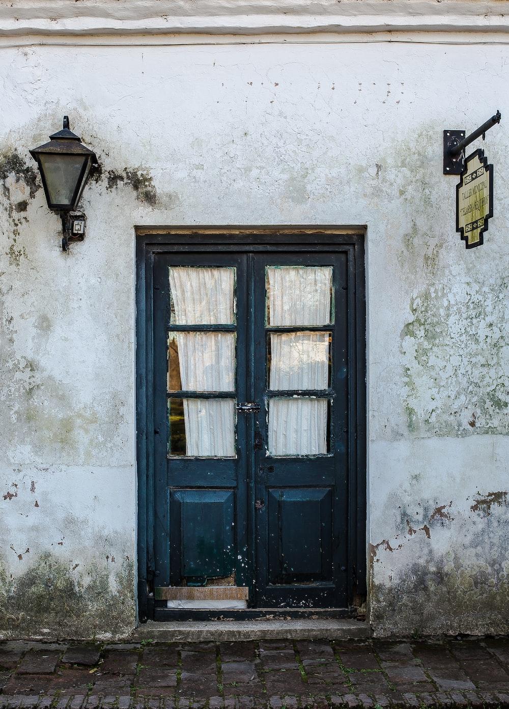 blue wooden door panel in white building