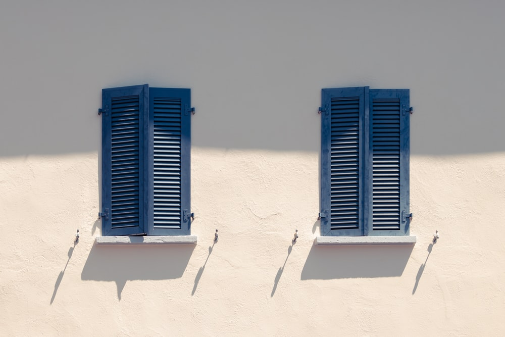 two blue wooden windows