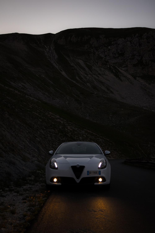 white car near mountain