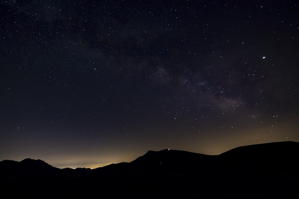 silhouette of moutain under stary sky