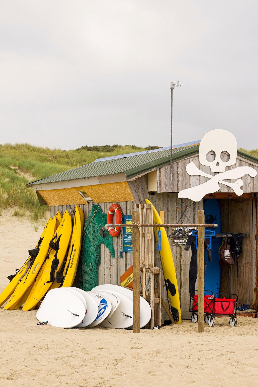 yellow paddle and skim board lot