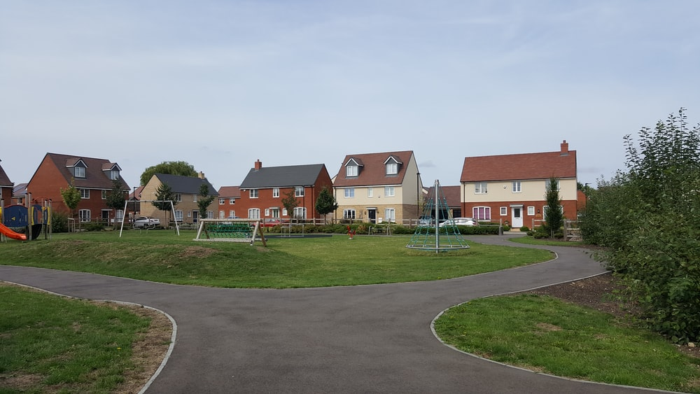 houses near play yard during daytime