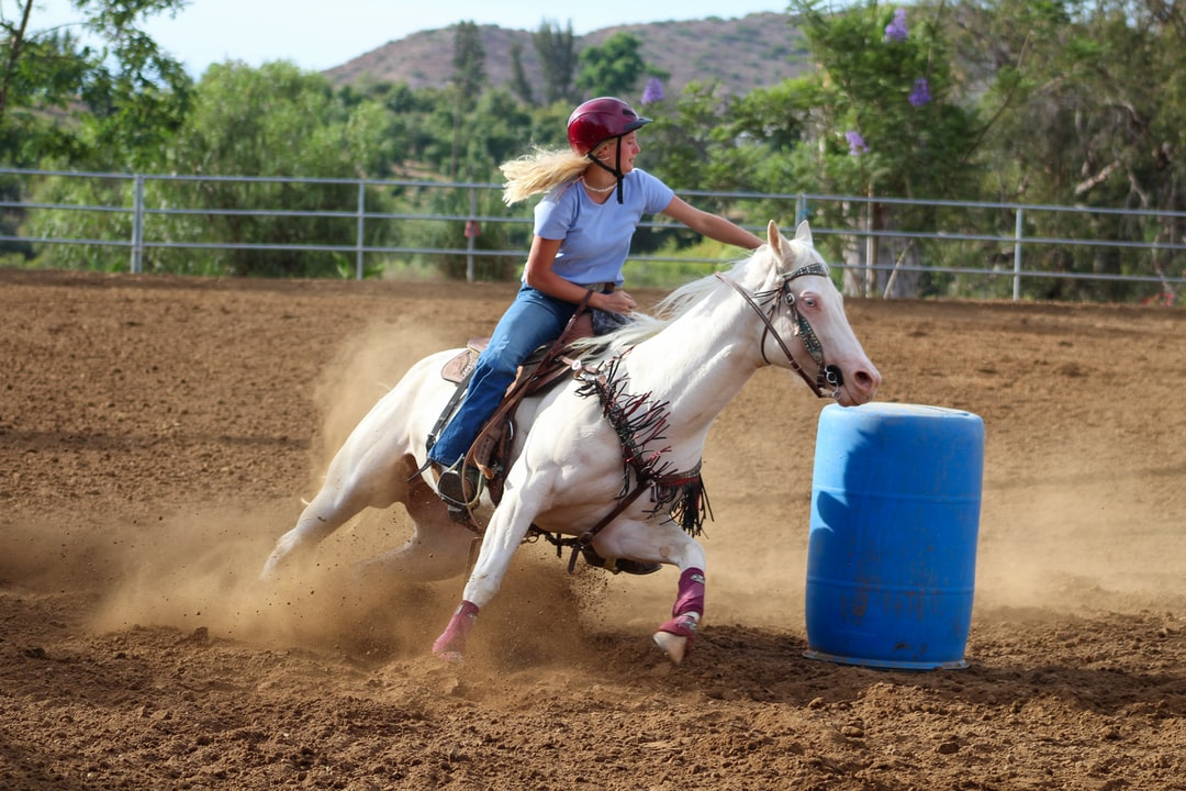 This is Marlene on Icy, doing a sliding turn around barrel #2. Turning around a barrel on horseback is very different than turning on a bike or motorcycle, in that you need to lean AWAY from the barrel rather than leaning in. It counter balances the horse and allows the horse to spin more quickly. I try to feature equestrian photos where riders are wearing helmets.