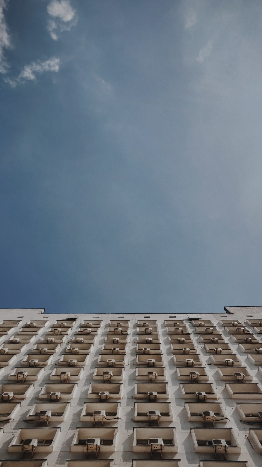 low angle photography of brown and white building