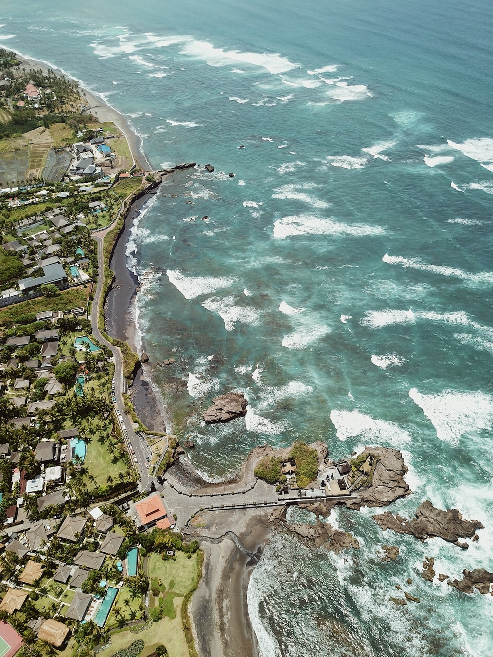 aerial photography of buildings on shore