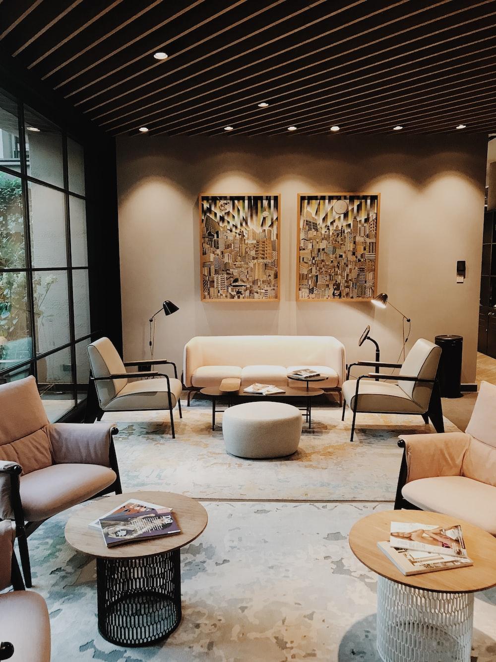 black metal framed beige padded sofa set inside room