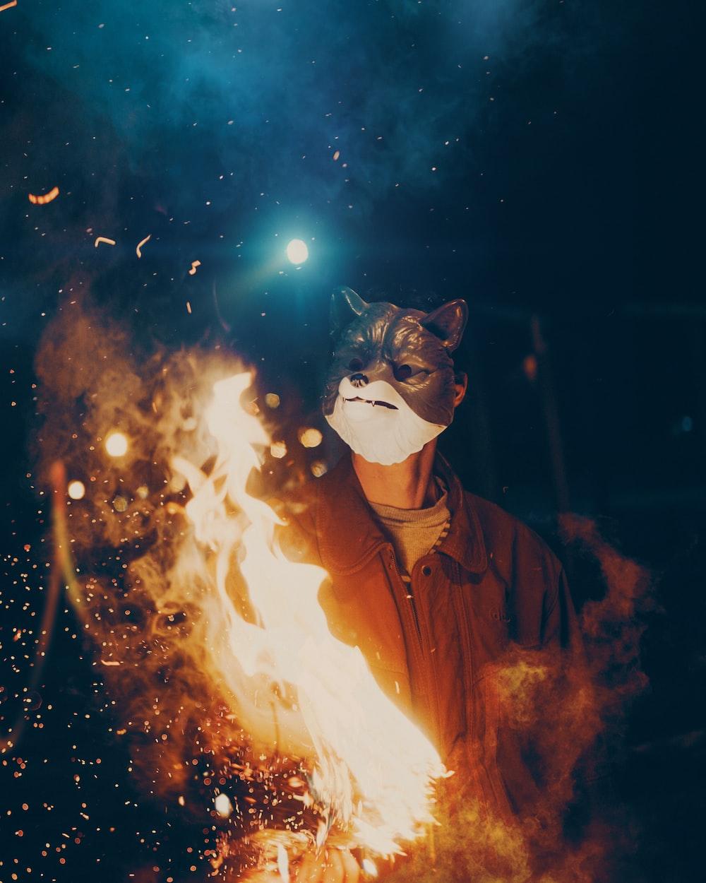 man in fox mask wearing black jacket