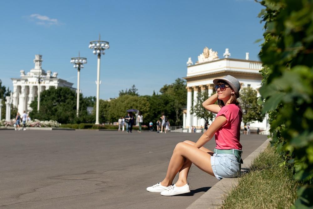 woman sitting near the road