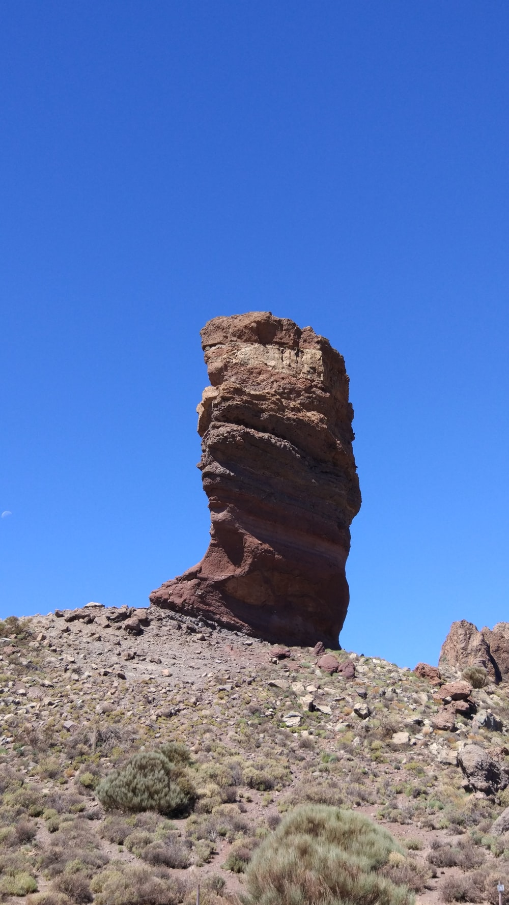 brown rock formation on hill