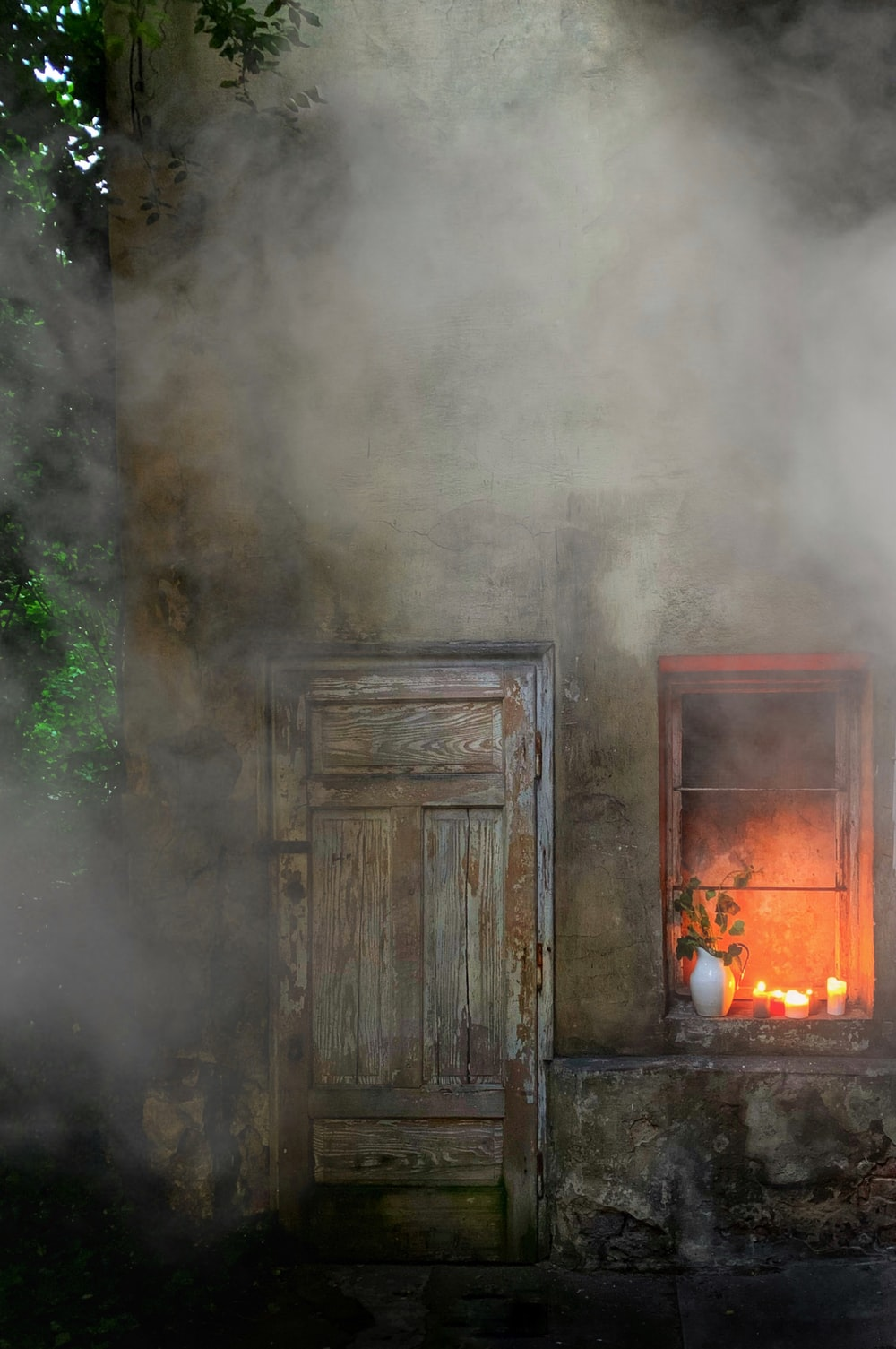 time-lapse photography of smoke coming from a burning house
