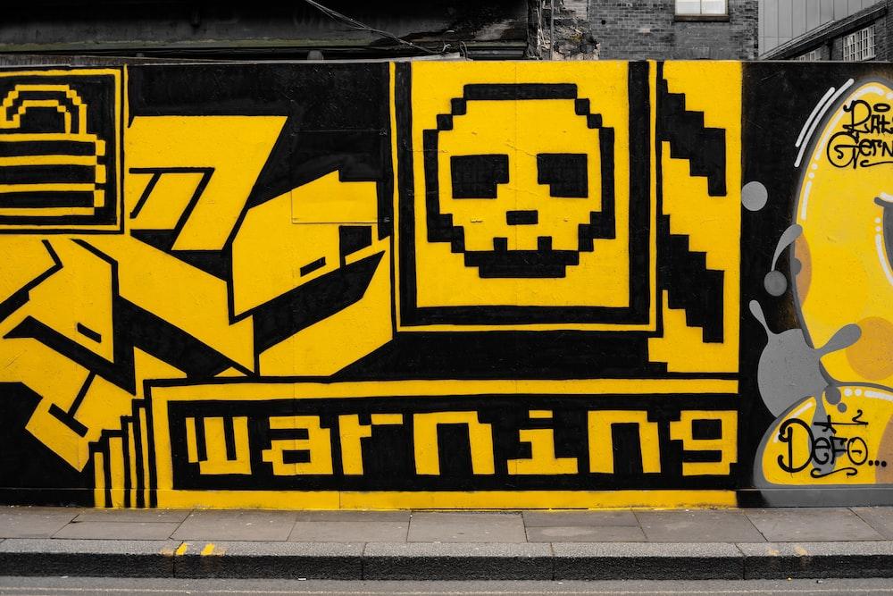 yellow and black Warning graffiti