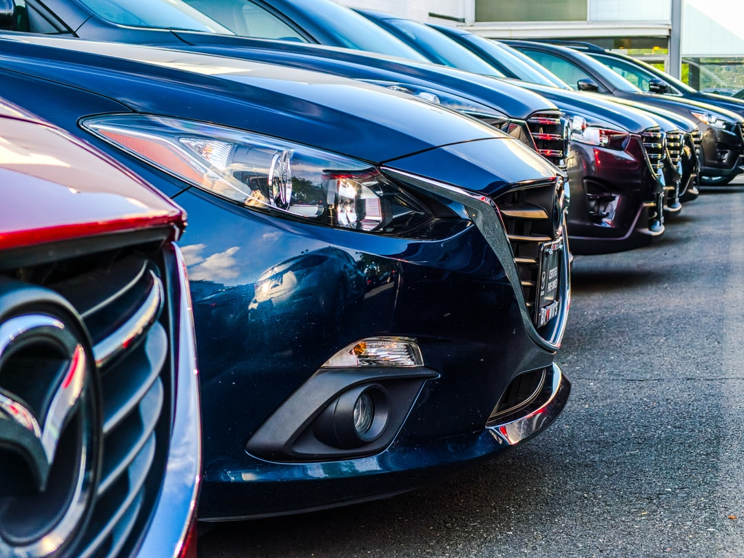 A row of Mazda 3s at a dealership in Fairfax VA