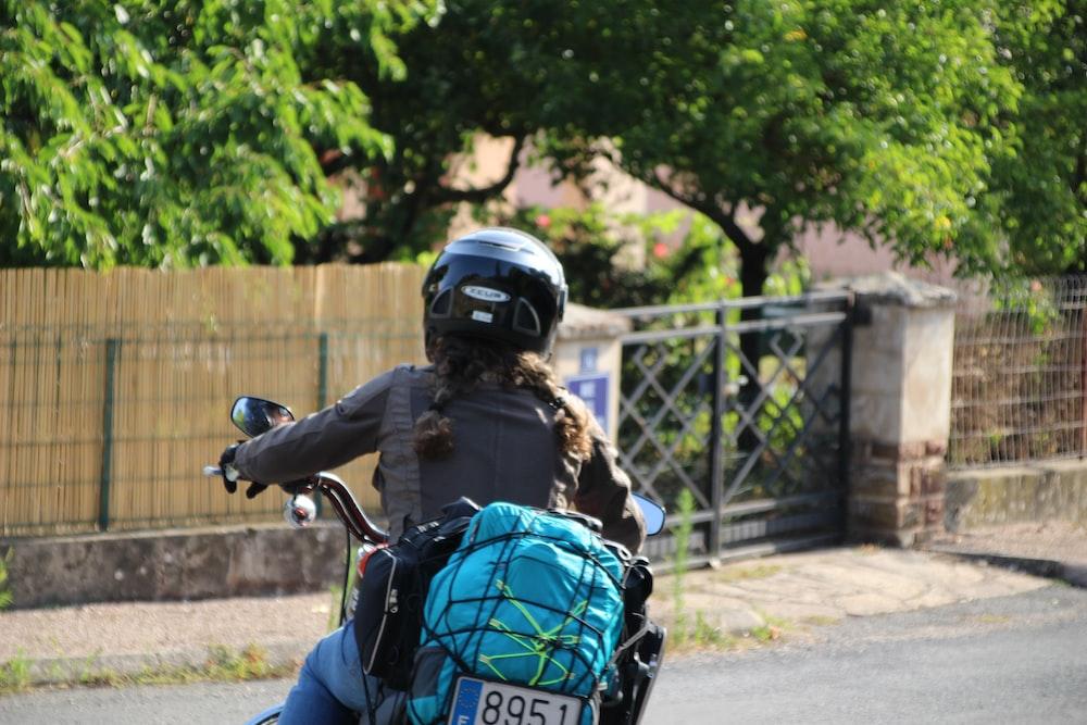 woman riding black motorcycle