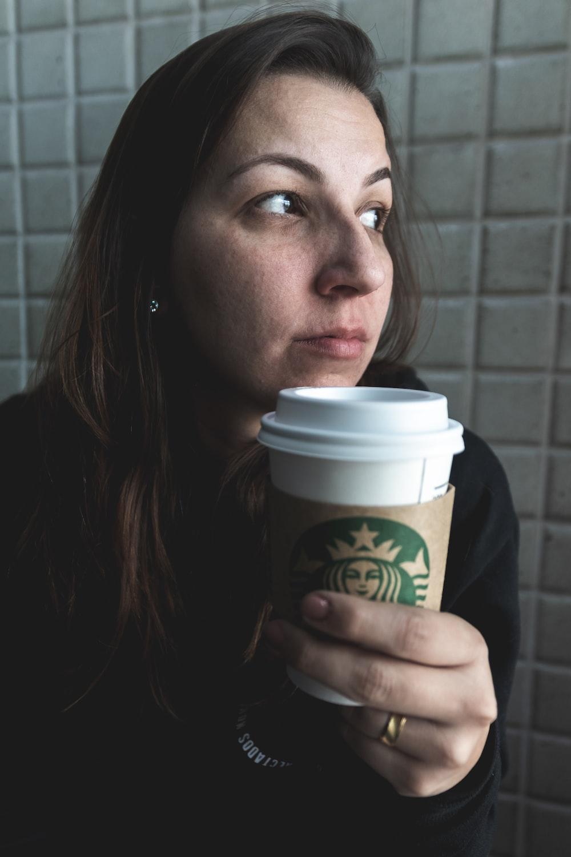 woman drinking Starbucks cup